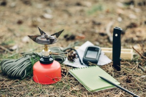 Emergency preparation equipment on the grass, on the nature background